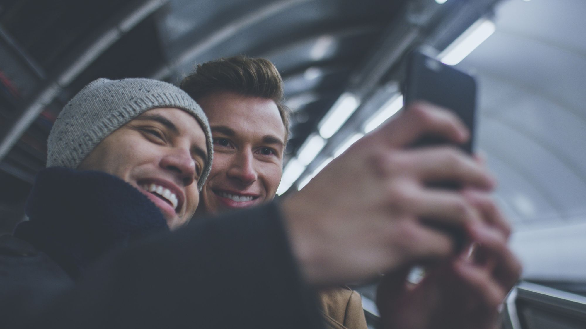 Couple_Taking_Selfie_In_Train_Station  3