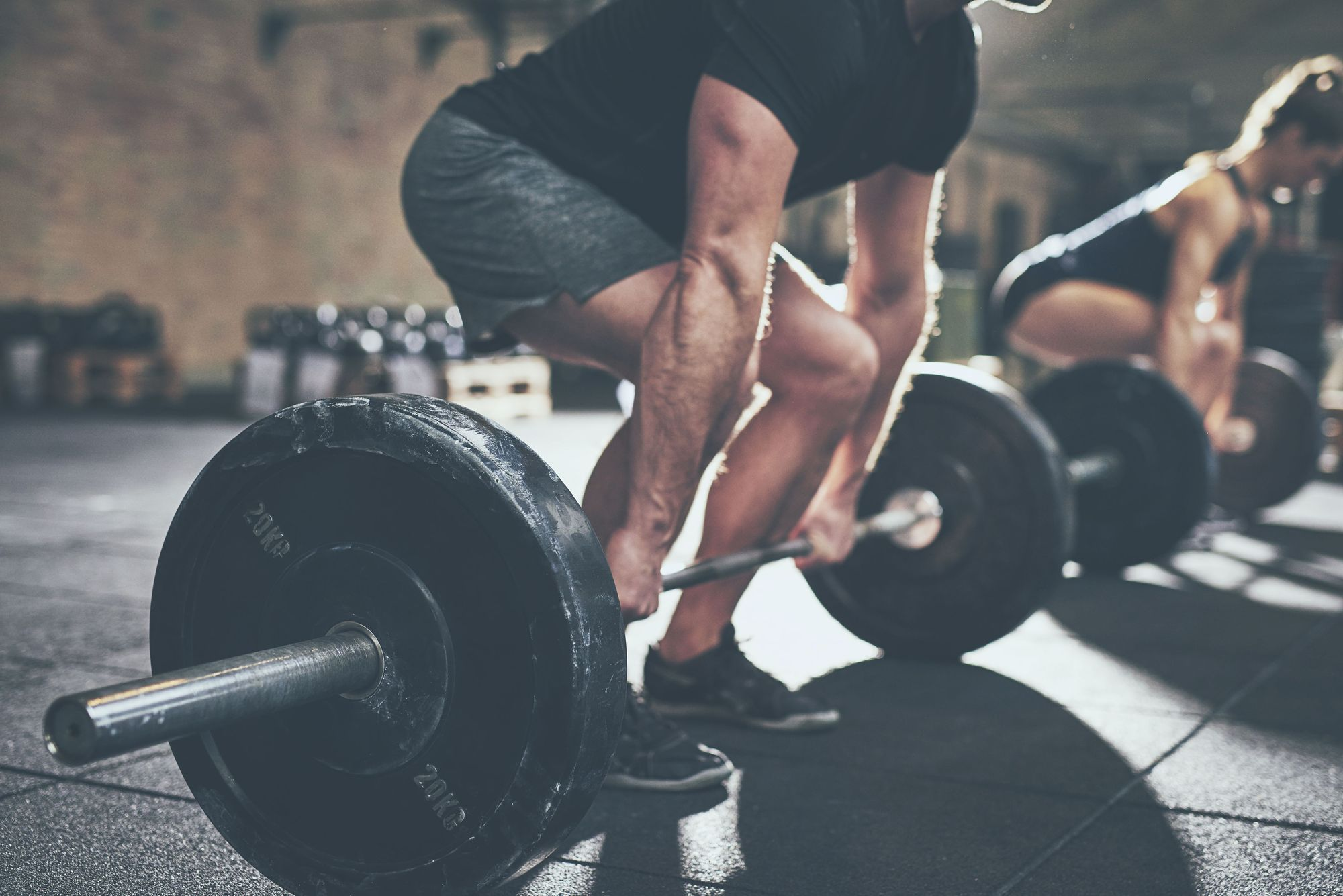 Man lifting weights in the gym