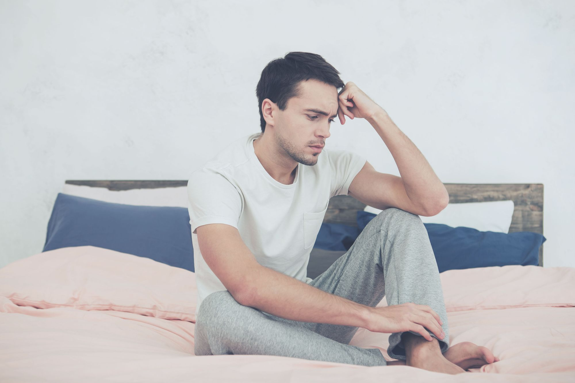 Stressed young man on bed