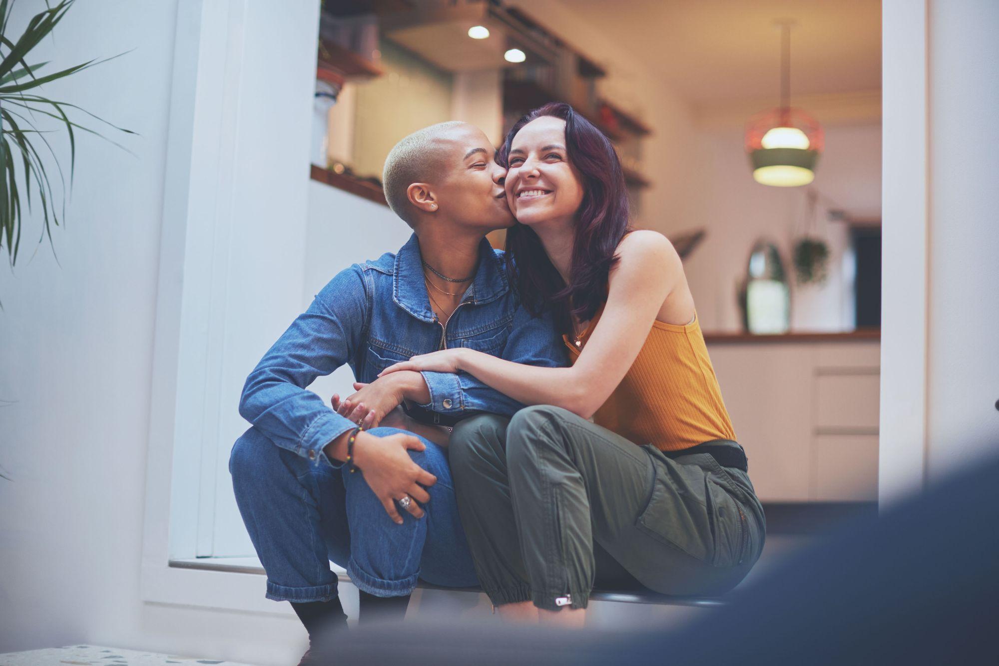 Happy couple kiss on cheek